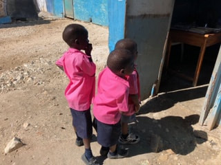 Aid In Haiti provides uniforms for all children